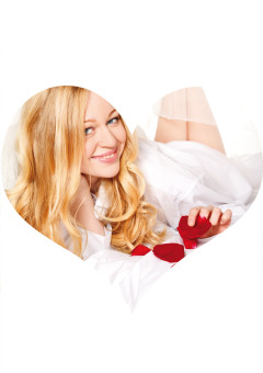 Happy Woman In Bed With Rose Petals